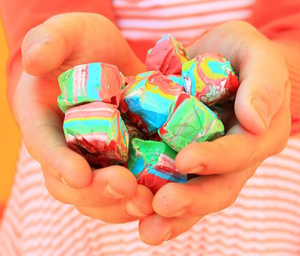 http://commons.wikimedia.org/wiki/File:Free_Child_Holding_Happy_Colorful_Rainbow_Taffy_Candy_(unedited)_Creative_Commons_(3354087435).jpg